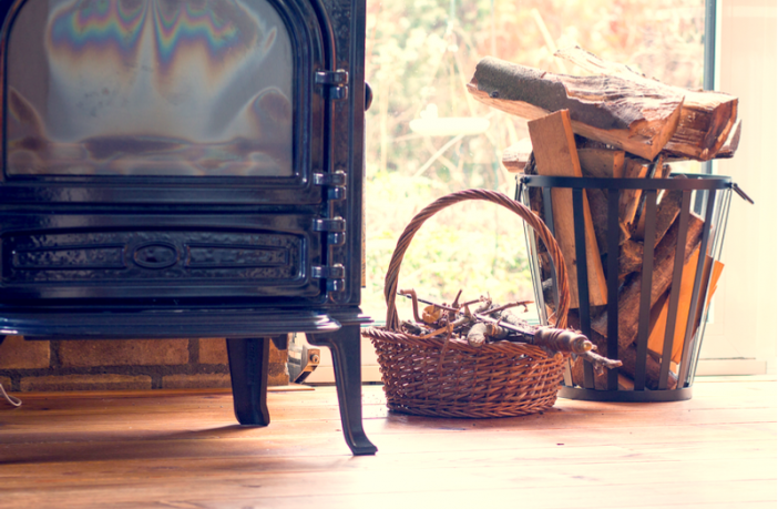 Wood Burning Stove With Basket of Logs
