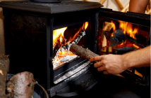 Adding wood to stove