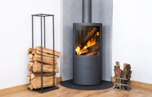 Defra stove with two piles of logs