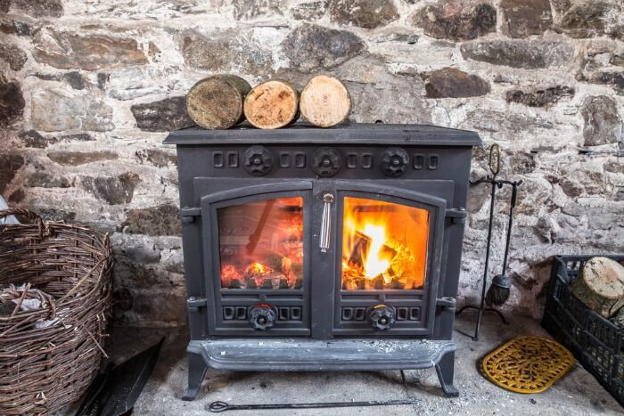 wood burning stove with logs and fire