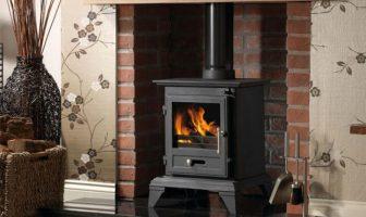 budget log burner in brick fireplace
