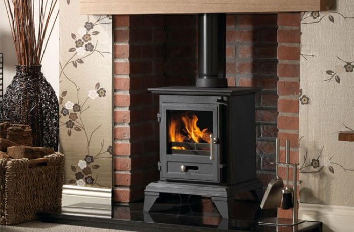 budget log burner in brick fireplace