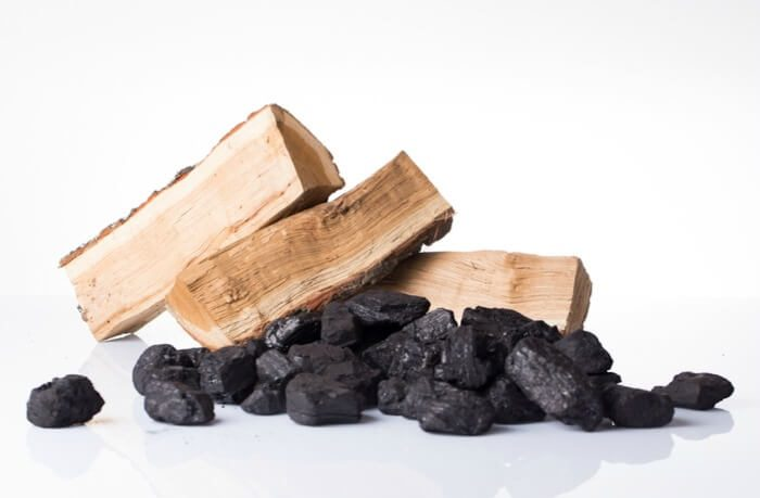 wood logs and coal in a pile