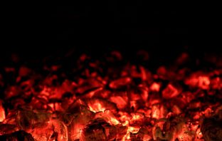 Stove fire embers dying out