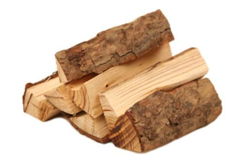 Pile of seasoned firewood on white background