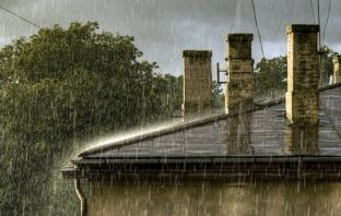 Houses with Chimney stacks in rain