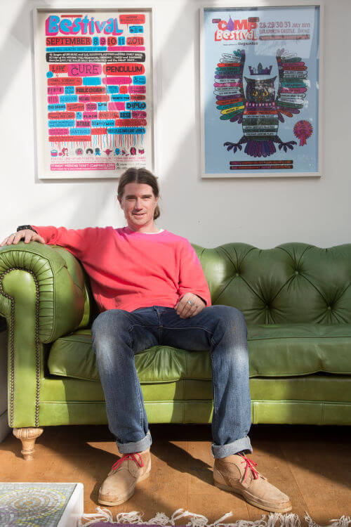 Rob da Bank sitting on his sofa at his Isle of Wight House