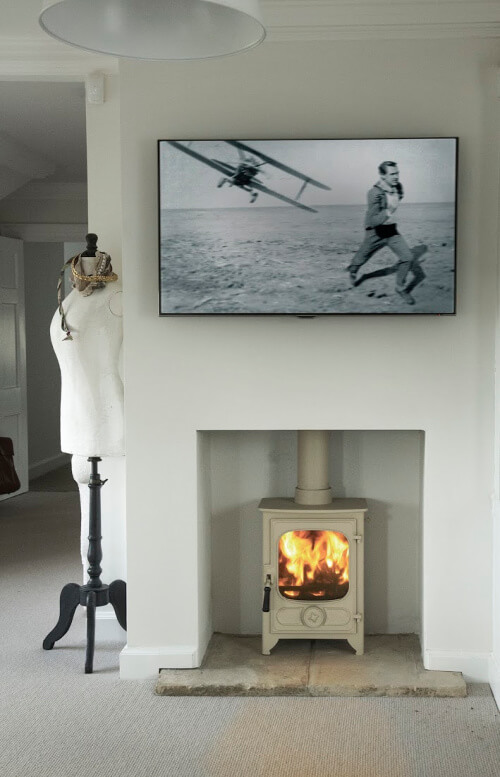 Charnwoon stove in bedroom hearth