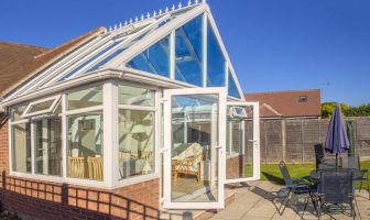 Conservatory on bright day with blue sky